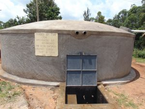 The Water Project:  Completed Rain Tank With Flowing Water
