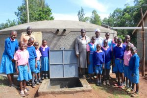 The Water Project:  Pupils Teachers And Staff Pose At Rain Tank