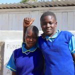 The Water Project: St. Michael Mukongolo Primary School -  Girls Pose In Front Of New Latrines