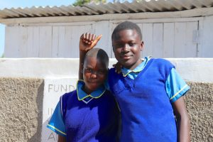 The Water Project:  Girls Pose In Front Of New Latrines