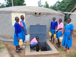 The Water Project:  Fetching Water From The Rain Tank