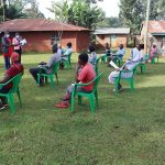 The Water Project: Shirakala Community, Ambani Spring -  Community Members Listening