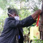 The Water Project: Malava Community, Ndevera Spring -  Hanging The Leaky Tin
