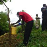 The Water Project: Mungakha Community, Nyanje Spring -  Trainer Protus Installs A Handwashing Station At The Spring
