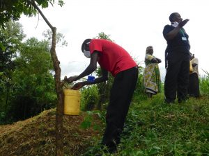The Water Project:  Trainer Protus Installs A Handwashing Station At The Spring