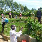 The Water Project: Eshiakhulo Community, Kweyu Spring -  Trainer Protus Demonstrates Handwashing