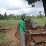 The Water Project: St. Michael Mukongolo Primary School -  Sifting Sand
