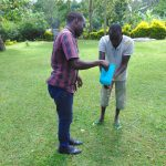 The Water Project: Shikangania Community, Abungana Spring -  Victor Pours Water For A Participant Washing His Hands