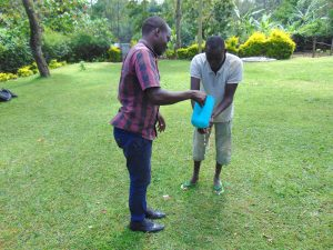 The Water Project:  Victor Pours Water For A Participant Washing His Hands