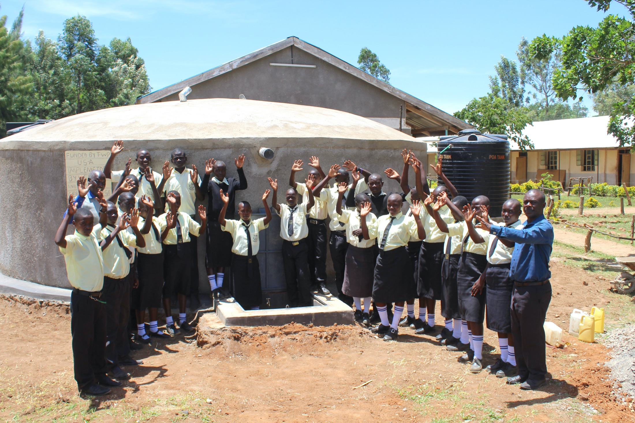 The Water Project : 42-kenya20107-pupils-and-staff-celebrate-the-new-rain-tank-1