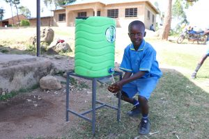 The Water Project:  A Boy Using The Handwashing Station