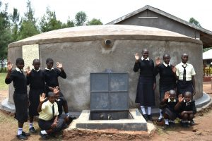 The Water Project:  Girls Posing At The Rain Tank