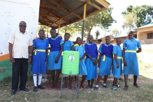 The Water Project:  The Ladies With Head Teacher Mutende And A Handwashing Station