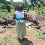 The Water Project: Shikangania Community, Abungana Spring -  Participant Holds Training Diagram