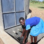 The Water Project: St. Michael Mukongolo Primary School -  A Girl Getting Water For Cleaning From The Tank