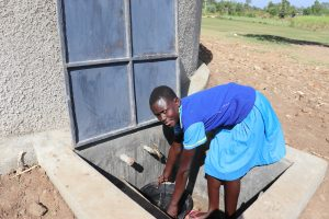 The Water Project:  A Girl Getting Water For Cleaning From The Tank