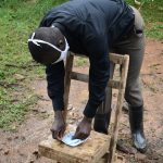 The Water Project: Maganyi Community, Bebei Spring -  Trainer Wagaka Demonstrating How To Make A Mask