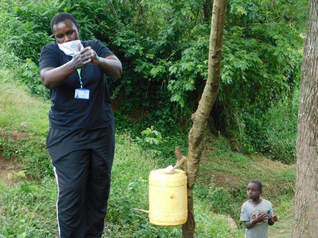The Water Project : 5-covid19-kenya18313-emmah-leads-handwashing-session