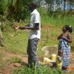 The Water Project: Emukoyani Community, Ombalasi Spring -  Trainer Protus Answers Questions