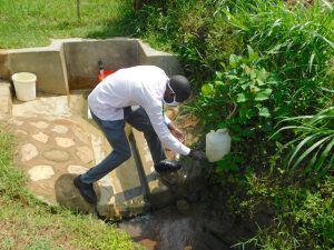 The Water Project:  Protus Rinses His Hands At The Leaky Tin