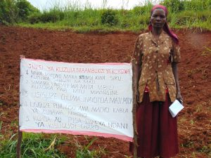 The Water Project:  Standing With Chart Placed At The Spring
