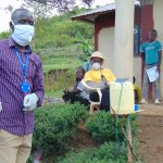 The Water Project: Ulagai Community, Rose Obare Spring -  Facilitator With Protective Gear At The Training