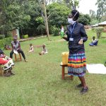 The Water Project: Lugango Community, Lugango Spring -  Covid Explaining Benefits Of Soap For Handwashing