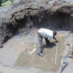 The Water Project: Shikangania Community, Abungana Spring -  Taking Measurements On Foundation