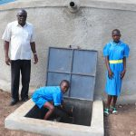 The Water Project: St. Michael Mukongolo Primary School -  Head Teacher Mutende With Pupils At The Water Point