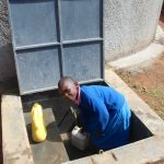 The Water Project: Kapsaoi Primary School -  Pupil Collecting Water