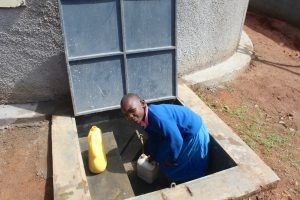The Water Project:  Pupil Collecting Water