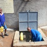 The Water Project: Kapsaoi Primary School -  Pupils Collecting Water