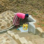 The Water Project: Shikangania Community, Abungana Spring -  Rinsing Container Before Fetching Water
