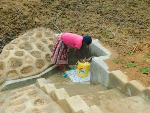 The Water Project:  Rinsing Container Before Fetching Water