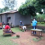 The Water Project: Chegulo Community, Yeni Spring -  Team Leader Catherine Emphasizes Handwashing And Social Distancing
