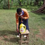 The Water Project: Ematetie Community, Weku Spring -  Trainer Amulavu Demonstrating Handwashing