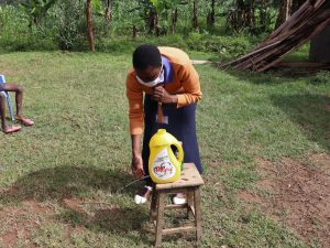 The Water Project:  Trainer Amulavu Demonstrating Handwashing