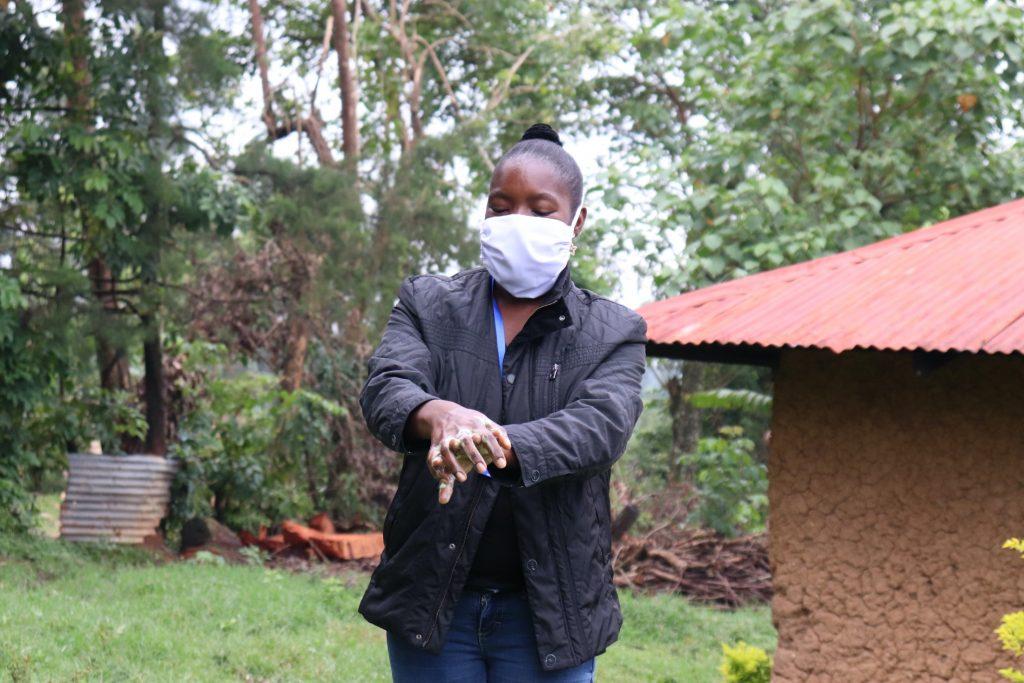 The Water Project : 6-covid19-kenya19098-trainer-masinde-taking-the-group-through-handwashing