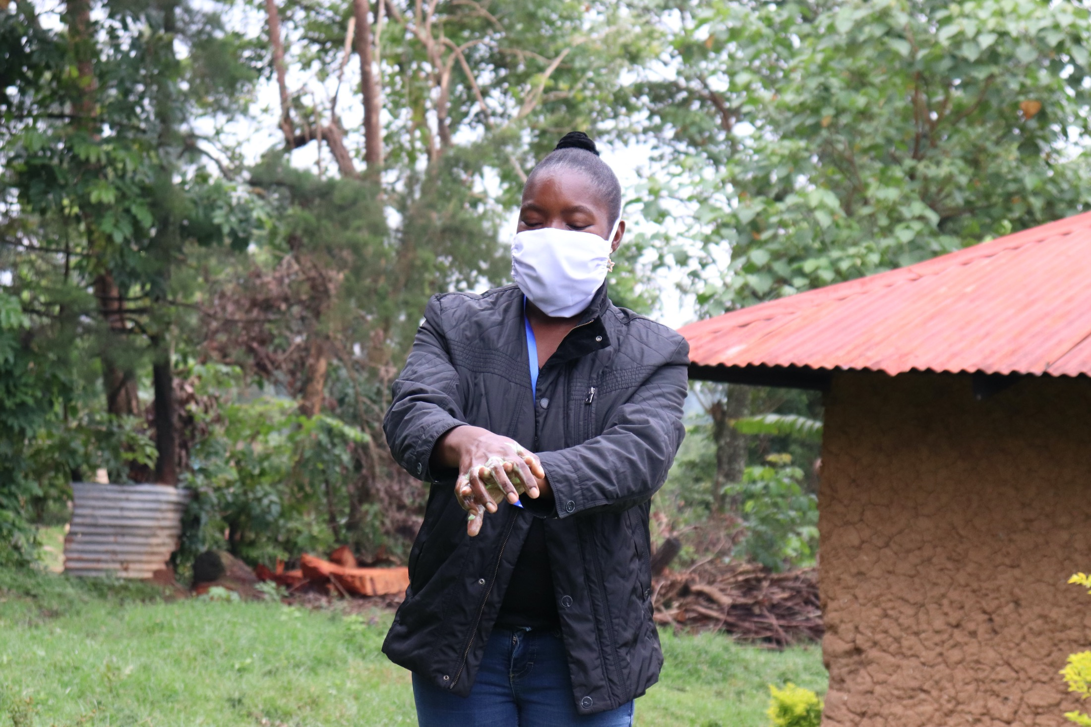 The Water Project : 6-covid19-kenya19098-trainer-masinde-taking-the-group-through-handwashing