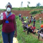 The Water Project: Shitaho Community B, Isaac Spring -  Facilitator Masinde With Sanitizer For Participants Hands