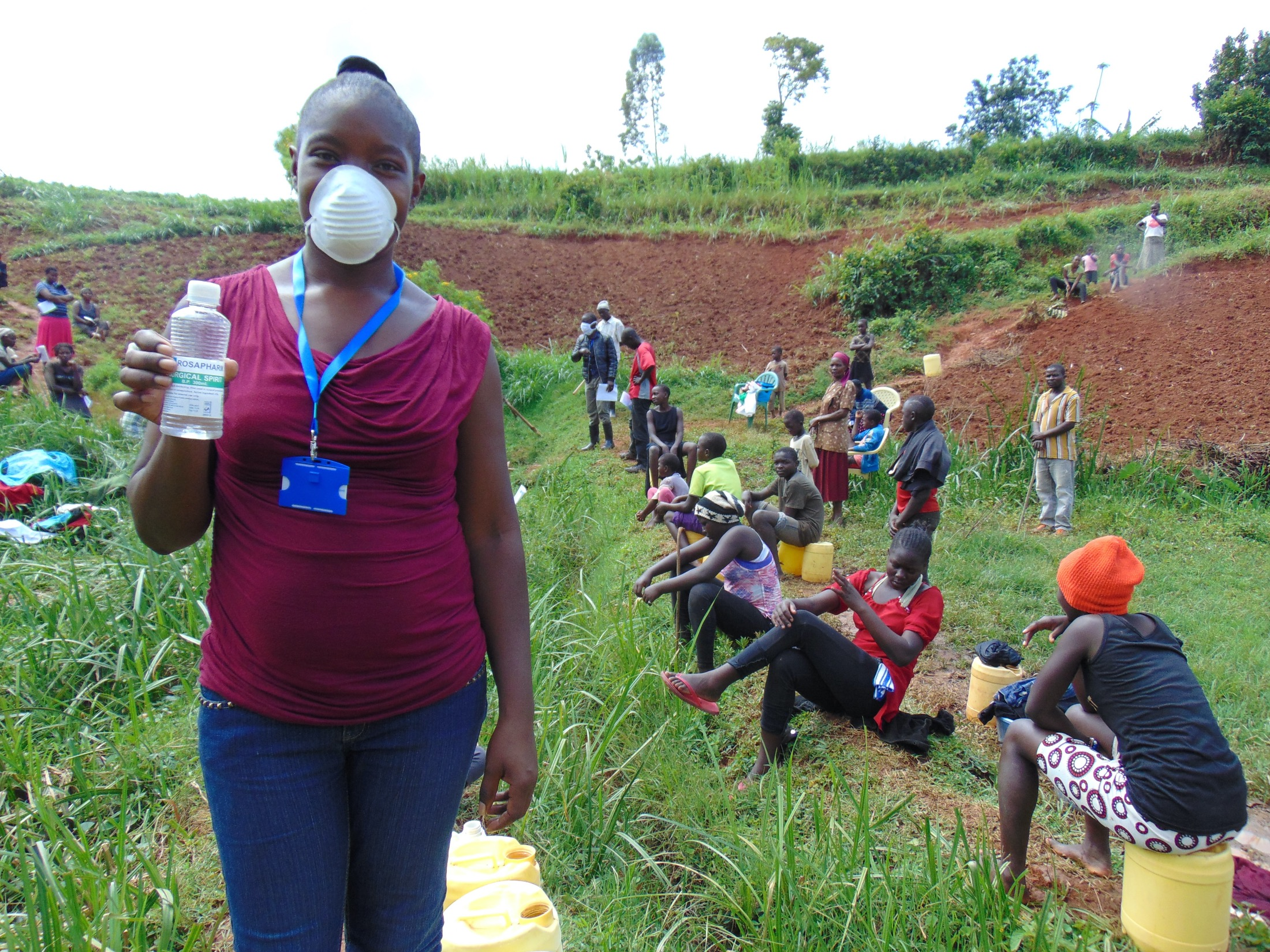 The Water Project : 6-covid19-kenya4711-facilitator-masinde-with-sanitizer-for-participants-hands