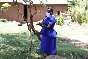 The Water Project:  Covid Trainer Karen Maruti Demonstrates Handwashing