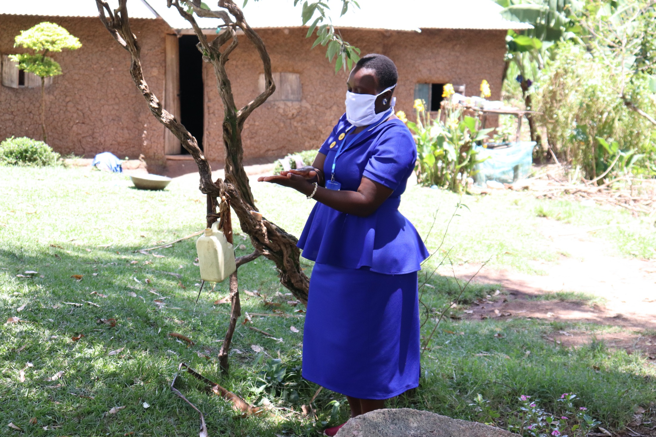 The Water Project : 6-kenya18153-covid-19-trainer-karen-maruti-demonstrates-handwashing