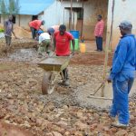 The Water Project: Jinjini Friends Primary School -  Laying Concrete