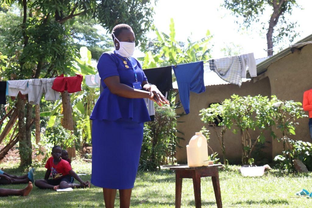 The Water Project : 6-kenya4585-covid19-trainer-karen-maruti-shows-ten-steps-of-handwashing