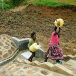 The Water Project: Shikangania Community, Abungana Spring -  Carrying Clean Water Home