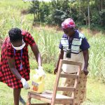 The Water Project: Emachembe Community, Mukabane Spring -  A Woman Steps Up To Wash Her Hands