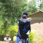 The Water Project: Chegulo Community, Yeni Spring -  Demonstrating Using Elbow To Cough Or Sneeze