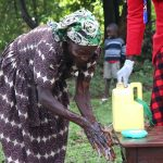 The Water Project: Emachembe Community, Hosea Spring -  Handwashing Demonstration