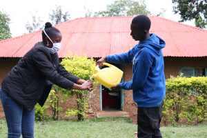 The Water Project:  Assisintg The Facilitator To Rinse Her Hands